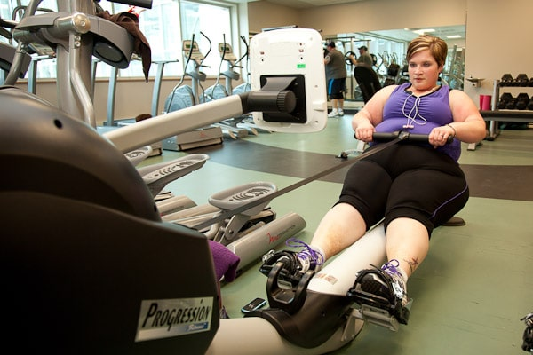 Women with obesity doing her gym workouts