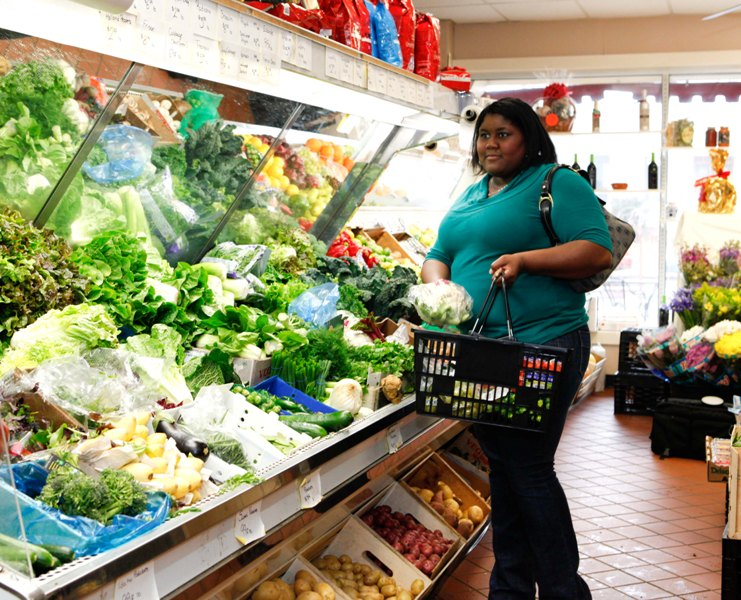A women shopping for vegetables in a food store. Consumption of fruits and vegetables are very useful in formulation of very low calorie diets.